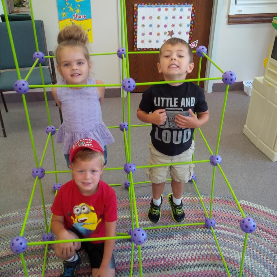 Balls & Sticks Cubed maze with three children inside